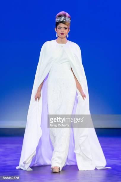 A model walks the runway wearing a Julie Danforth design at the Metropolitan Fashion Week Closing Night Gala at Arcadia Performing Arts Center on...