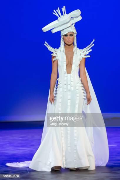 A model walks the runway wearing a Marika Soderlund Robison design at the Metropolitan Fashion Week Closing Night Gala at Arcadia Performing Arts...