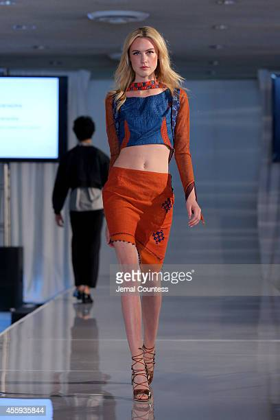 Model walks the runway wearing a piece from collections produced by women artisans of the International Trade Centres during the Women Empowering...