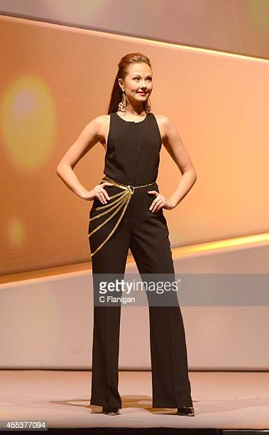 A model walks the runway wearing a piece from the Impulse Fashion collection at the 2014 Macy's Passport Glamorama Fashion Rocks show at The Golden...