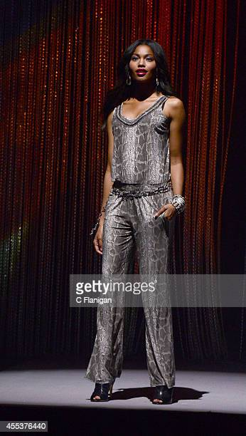 A model walks the runway wearing a piece from the INC international Concepts collection at the 2014 Macy's Passport Glamorama Fashion Rocks show at...