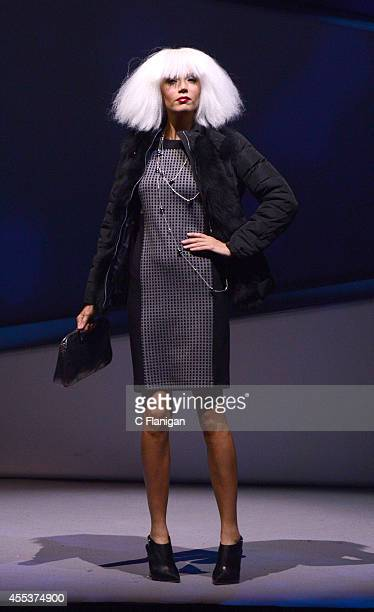A model walks the runway wearing a piece from the Weekend by Max Mara collection at the 2014 Macy's Passport Glamorama Fashion Rocks show at The...