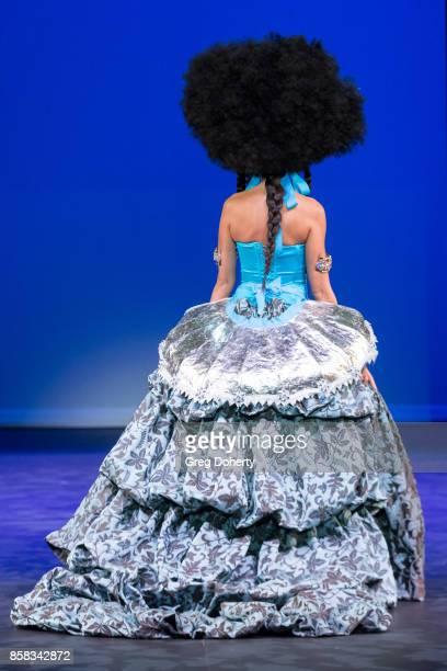 A model walks the runway wearing a Ricardo Saltero design at the Metropolitan Fashion Week Closing Night Gala at Arcadia Performing Arts Center on...