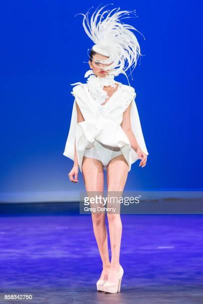 A model walks the runway wearing a Xavier Othon design at the Metropolitan Fashion Week Closing Night Gala at Arcadia Performing Arts Center on...