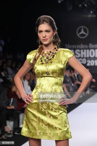 Model walks the runway wearing Alberto Rodriguez Spring/Summer 2010 during Mercedes-Benz Fashion Mexico at the Antara Polanco Fashion Hall on October...
