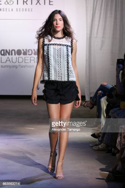 A model walks the runway wearing Alice Trixie by Angela George at Underground Lauderdale Fashion Weekend Brought To You By The Greater Fort...