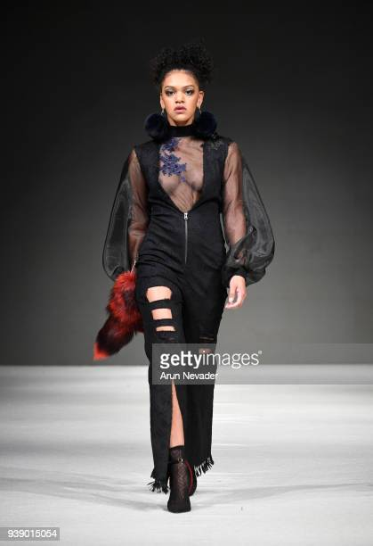 A model walks the runway wearing Alicia Perrillo at 2018 Vancouver Fashion Week Day 6 on March 24 2018 in Vancouver Canada