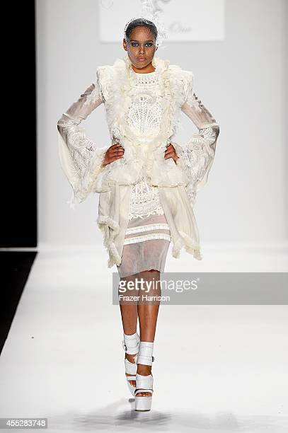 A model walks the runway wearing Amato Haute Couture at the Art Hearts fashion show presented by AIDS Healthcare Foundation during MercedesBenz...