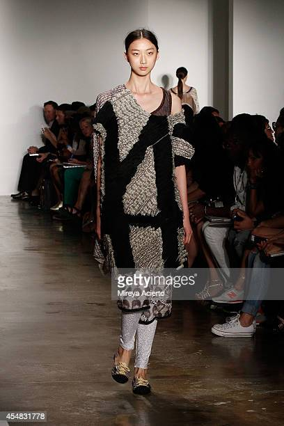 A model walks the runway wearing Ammar Belal's collections at Parsons MFA runway show during MADE Fashion Week Spring 2015 at Milk Studios on...