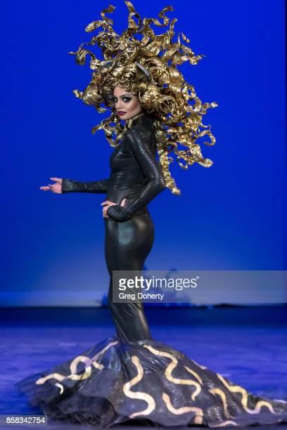 A model walks the runway wearing an Inoe Vargas design at the Metropolitan Fashion Week Closing Night Gala at Arcadia Performing Arts Center on...