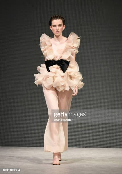 A model walks the runway wearing Andrea Tetangco Vancouver Fashion Week Spring/Summer 19 Day 5 on September 21 2018 in Vancouver Canada