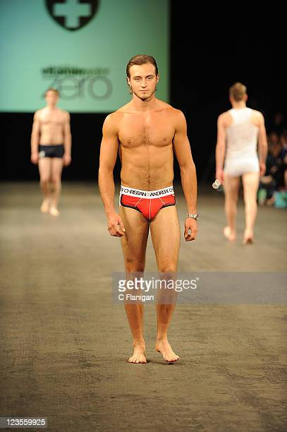 A model walks the runway wearing Andrew Christian during the 2011 Charity Fashion Show at the Fort Mason Center Festival Pavilion on April 2 2011 in...
