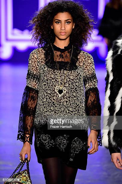 A model walks the runway wearing Anna Sui Fall 2016 during New York Fashion Week The Shows at The Arc Skylight at Moynihan Station on February 17...