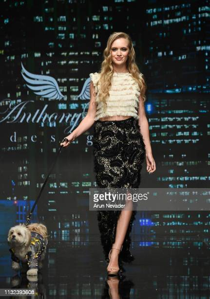 A model walks the runway wearing Anthony Rubio at Los Angeles Fashion Week FW/19 Powered by Art Hearts Fashion at The Majestic Downtown on March 23...