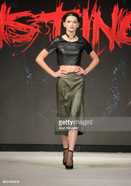 A model walks the runway wearing Asli Katina Bozdag at 2017 Vancouver Fashion Week Day 3 on September 20 2017 in Vancouver Canada