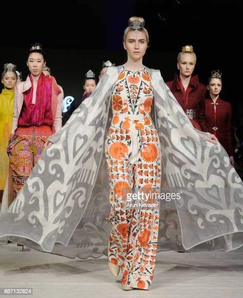 Model walks the runway wearing at Vancouver Fashion Week Fall/Winter 2017 at Chinese Cultural Centre of Greater Vancouver on March 23, 2017 in...
