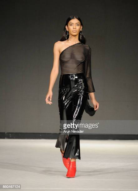A model walks the runway wearing Atelier Guarin at 2017 Vancouver Fashion Week Day 3 on September 20 2017 in Vancouver Canada