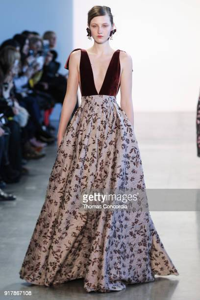 A model walks the runway wearing Badgley Mischka Fall 2018 at Gallery I at Spring Studios on February 13 2018 in New York City