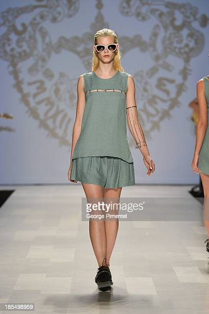 A model walks the runway wearing Beaufille spring 2014 collection during World MasterCard Fashion Week Spring 2014 at David Pecaut Square on October...
