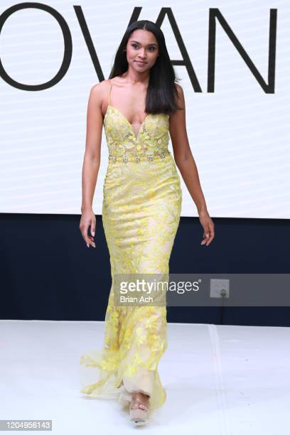 Model walks the runway wearing Bebe's and Liz's presents JOVANI during NYFW Powered By hiTechMODA on February 08, 2020 in New York City.