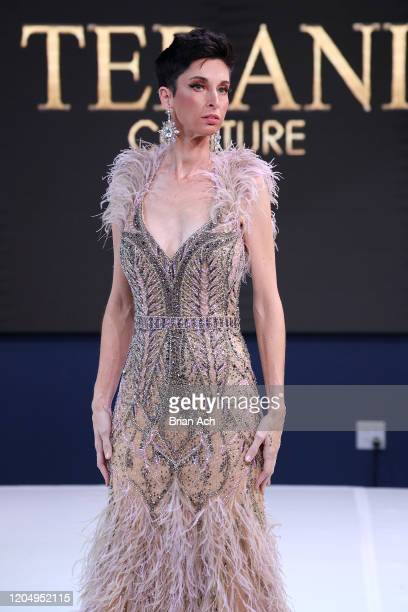 Model walks the runway wearing Bebe's and Liz's presents TERANI Couture during NYFW Powered By hiTechMODA on February 08, 2020 in New York City.