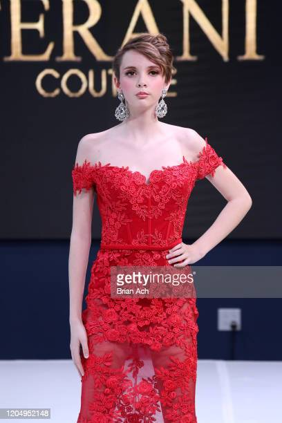 A model walks the runway wearing Bebe's and Liz's presents TERANI Couture during NYFW Powered By hiTechMODA on February 08 2020 in New York City