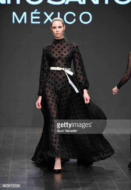 A model walks the runway wearing Benito Santos at Los Angeles Fashion Week Powered by Art Hearts Fashion LAFW FW/18 10th Season Anniversary at The...