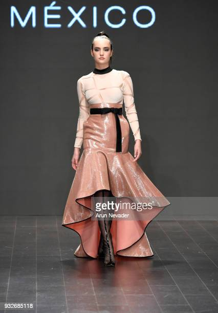 A model walks the runway wearing Benito Santos at Los Angeles Fashion Week Powered by Art Hearts Fashion LAFW FW/18 10th Season Anniversary at The...