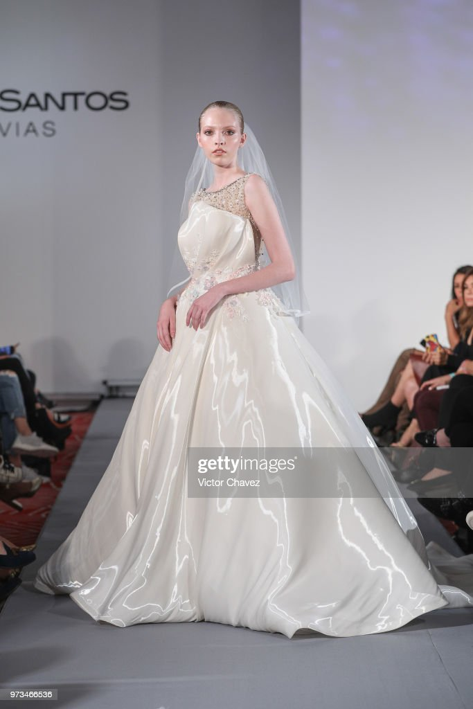 A model walks the runway wearing Benito Santos brides collection during the Mexico Bridal Show by Vogue at Four Seasons hotel on June 13, 2018 in Mexico City, Mexico.