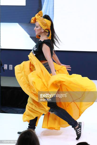Model walks the runway wearing Bombazo Wear Bomba Carribbean Skirts during NYFW Powered By hiTechMODA on February 08, 2020 in New York City.