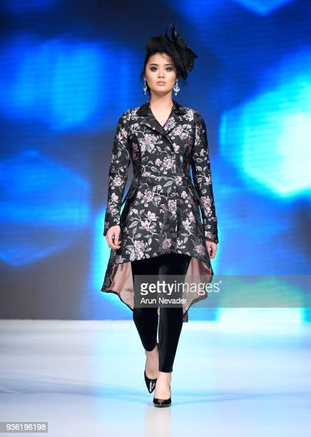 Model walks the runway wearing Bone and Busk by Katharina Mior at 2018 Vancouver Fashion Week - Day 2 on March 20, 2018 in Vancouver, Canada.