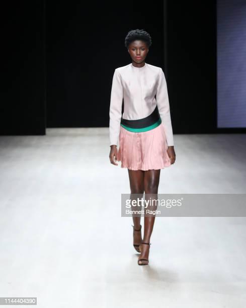 Model walks the runway wearing Bridget Awosika during Arise Fashion Week on April 21, 2019 in Lagos, Nigeria.