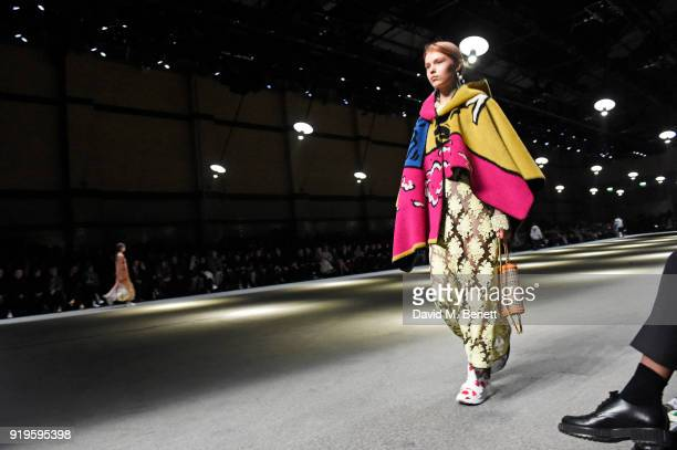 A model walks the runway wearing Burberry at the Burberry February 2018 show during London Fashion Week at Dimco Buildings on February 17 2018 in...