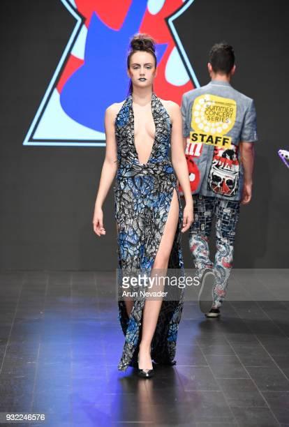 A model walks the runway wearing Burning Guitars Clothing at Los Angeles Fashion Week Powered by Art Hearts Fashion LAFW FW/18 10th Season...