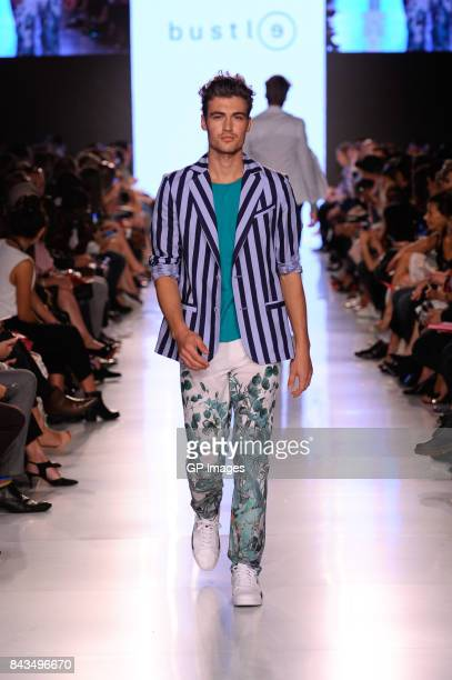 A model walks the runway wearing Bustle 2017 at BloorYorkville on September 6 2017 in Toronto Canada
