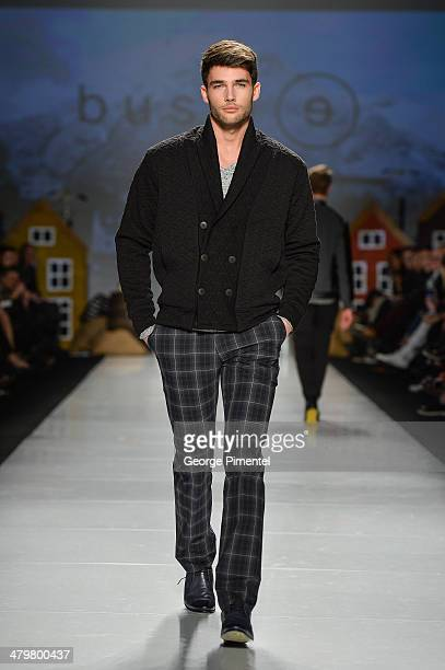 A model walks the runway wearing Bustle fall 2014 collection during World MasterCard Fashion Week Fall 2014 at David Pecaut Square on March 20 2014...