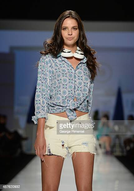 A model walks the runway wearing Bustle spring 2015 collection during World MasterCard Fashion Week Spring 2015 at David Pecaut Square on October 21...