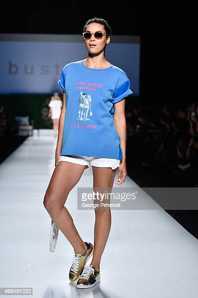 A model walks the runway wearing Bustle spring 2016 collection during World MasterCard Fashion Week Spring 2016 at David Pecaut Square on October 20...