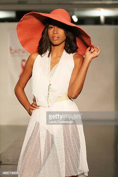 Model walks the runway wearing Caitlin Kelly design at the Hairshion fashion show during MercedesBenz Fashion Week Fall 2014 at Alvin Alley Studios...