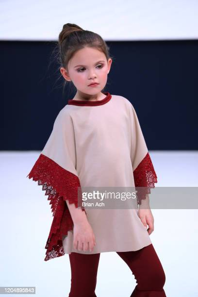 A model walks the runway wearing Camellia Couture during NYFW Powered By hiTechMODA on February 08 2020 in New York City