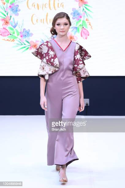 Model walks the runway wearing Camellia Couture during NYFW Powered By hiTechMODA on February 08, 2020 in New York City.