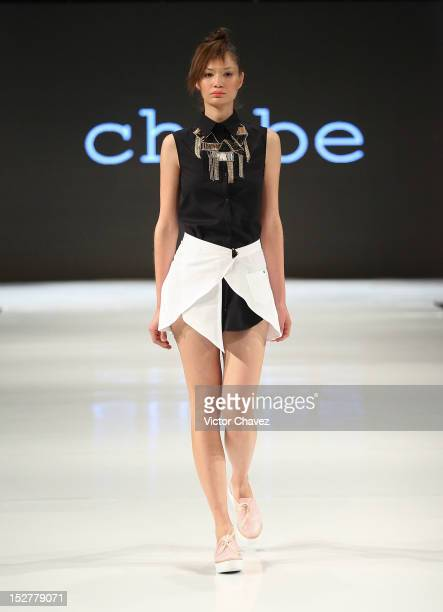 A model walks the runway wearing Chabe during the first day of Google Fashion Mexico at Estudios Churubusco on September 25 2012 in Mexico City Mexico