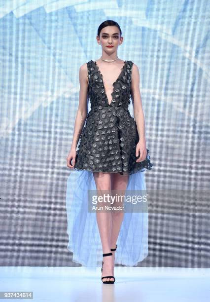 A model walks the runway wearing Chany Venturini at 2018 Vancouver Fashion Week Day 4 on March 22 2018 in Vancouver Canada