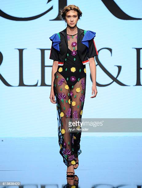 A model walks the runway wearing Charles and Ron at Art Hearts Fashion Los Angeles Fashion Week presented by AIDS Healthcare Foundation on October 10...