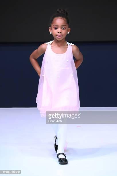 Model walks the runway wearing CHINO' ARTE' BY WAYNE during NYFW Powered By hiTechMODA on February 08, 2020 in New York City.
