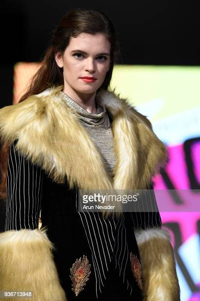 A model walks the runway wearing Circus Circus by Katheryn Potter at VCC Fashion Grad Exhibit at 2018 Vancouver Fashion Week Day 3 on March 21 2018...