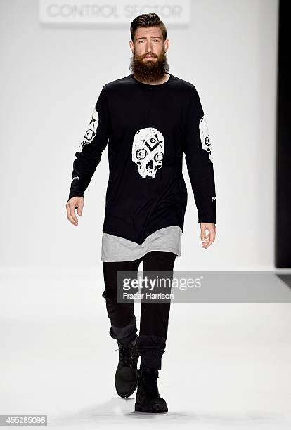 A model walks the runway wearing Control Sector at the Art Hearts fashion show presented by AIDS Healthcare Foundation during MercedesBenz Fashion...