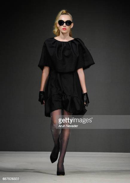 A model walks the runway wearing Cooper Hotcooture at Vancouver Fashion Week Fall/Winter 2017 at Chinese Cultural Centre of Greater Vancouver on...