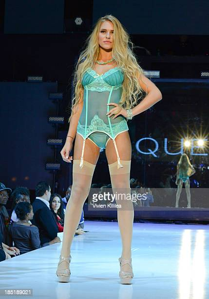 A model walks the runway wearing Coquette at Fashion Minga ArtMusicDance at Exchange LA on October 17 2013 in Los Angeles California