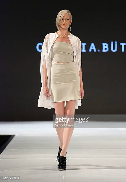 A model walks the runway wearing Cynthia Buttenklepper during the first day of Google Fashion Mexico at Estudios Churubusco on September 25 2012 in...